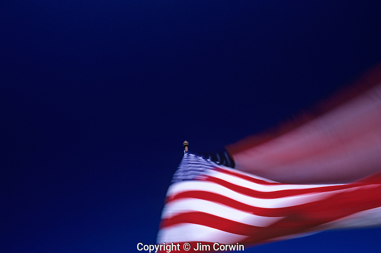 American Flag, Stars and Stripes, blurred, waving in the wind with blue sky, Lynnwood, Washington USA