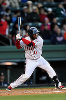 Second baseman Wendell Rijo (11) of the Greenville Drive bats in a game against the Charleston RiverDogs on Wednesday, April 16, 2014, at Fluor Field at the West End in Greenville, South Carolina. Rijo is the No. 18 prospect of the Boston Red Sox, according to Baseball America. Charleston won, 8-7. (Tom Priddy/Four Seam Images) (Tom Priddy/Four Seam Images)