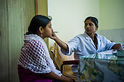 A doctor checks a patient at the  OPD of the National Research Institute of Panchakarma in Cheruthuruthy in Thissur district of Kerala, India.