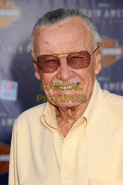 "Stan Lee.Premiere of ""Captain America: The First Avenger"" held at The El Capitan Theatre in Hollywood, California, USA..July 19th, 2011.headshot portrait moustache mustache facial hair smiling shirt yellow tinted glasses sunglasses shades .CAP/ADM/BP.©Byron Purvis/AdMedia/Capital Pictures."