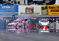 Oct 4, 2015; Mohnton, PA, USA; NHRA funny car driver Courtney Force (left) loses control and goes sideways alongside Cruz Pedregon during the Keystone Nationals at Maple Grove Raceway. Mandatory Credit: Mark J. Rebilas-USA TODAY Sports