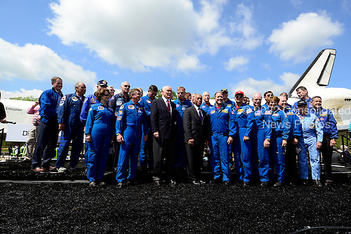 Group photo featuring former United States Senator John H. Glenn (Democrat of Ohio), and the first American to Orbit the Earth; and NASA Administrator Charles F. Bolden, Jr. and former Discovery Mission Commanders and Mission Specialists following the ceremony where the Space Shuttle Discovery was signed over to replace the Space Shuttle Enterprise in Chantilly, Virginia awaiting the arrival of the  on Thursday, April 19, 2012. Both Glenn and Bolden flew into space aboard Discovery. .Credit: Ron Sachs / CNP.(RESTRICTION: NO New York or New Jersey Newspapers or newspapers within a 75 mile radius of New York City)