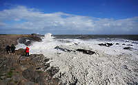WINDY WEATHER WALES<br /> Pictured: Foam formed by the waves crashing against the promenade wall near the lighthouse in Porthcawl, south Wales, UK. Tuesday 06 June 2017<br /> Re: Strong winds have been affecting parts of the UK