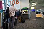 Passengers at departure boarding gate, Gatwick airport north terminal, London, England, UK