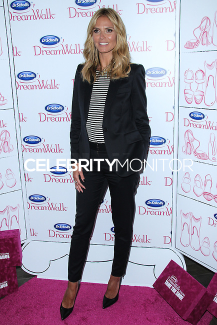 NEW YORK CITY, NY, USA - APRIL 02: Model Heidi Klum arrives at the Dr. Scholl's DreamWalk Line Launch held at Gansevoort Park Avenue on April 2, 2014 in New York City, New York, United States. (Photo by Jeffery Duran/Celebrity Monitor)