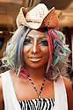 Erimokkori, a member of staff, poses for a picture at the Ganguro Cafe &amp; Bar in the Shibuya shopping area on September 4, 2015. <br /> <br /> Ganguro is an alternative Japanese fashion trend which started in the mid-1990s where young women, rebelling against the traditional idea of Japanese beauty, wore colorful make-up and clothes and had dark-skin.<br /> <br /> 10 Ganguro fashion girls work in the new bar, which offers original Ganguro Balls (fried takoyaki style sausage balls in black squid ink batter) on its menu. Ganguro Caf&eacute; &amp; Bar also offers special services such as Ganguro make-up and the chance to take purikura (photo booth pictures) with staff and to look like a Ganguro girl walking around the Shibuya streets.<br /> <br /> The bar is popular with both Japanese and foreigners and has menus translated in English. (Photo by Rodrigo Reyes Marin/AFLO)
