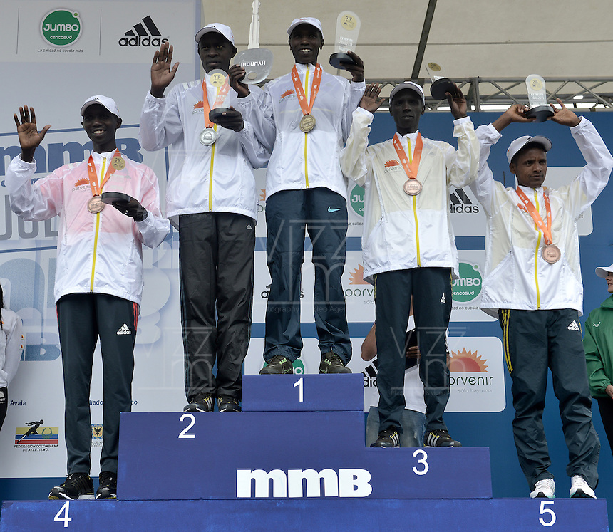 BOGOT&Aacute; -COLOMBIA. 28-07-2013. Aspecto del podium de ganadores en la Media Marat&oacute;n de Bogot&aacute; 2013. En esta ocasi&oacute;n Geoffrey Kipsang (Kenia) (centro) fue el ganador con un tiempo de 1.03:46 y en mujeres Priscah Jeptoo (Kenia)con un ntiempo de 1.12:24. / Aspect of the podium in the Half Marathon of Bogota. In this edition Geoffrey Kipsang (Kenya) (center) with a time of 1.03:46 and in women the winner  was Priscah Jeptoo (Kenya) with a time of 1.12:24. list of podium: <br /> 1. Geoffrey Kipsang (Kenia): 1.03:46<br /> 2. Peter Kirui (Kenia): 1.04.:48<br /> 3. Kiplimo Kimutai (Kennia): 1.05:15<br /> 4. Wilson Kipsang (Kenia): 1.05:26<br /> 5. Tewelde Estifanos (Eritrea): 1.05:37<br /> Photo: VizzorImage / Str