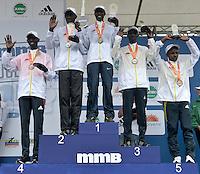 BOGOTÁ -COLOMBIA. 28-07-2013. Aspecto del podium de ganadores en la Media Maratón de Bogotá 2013. En esta ocasión Geoffrey Kipsang (Kenia) (centro) fue el ganador con un tiempo de 1.03:46 y en mujeres Priscah Jeptoo (Kenia)con un ntiempo de 1.12:24. / Aspect of the podium in the Half Marathon of Bogota. In this edition Geoffrey Kipsang (Kenya) (center) with a time of 1.03:46 and in women the winner  was Priscah Jeptoo (Kenya) with a time of 1.12:24. list of podium: <br /> 1. Geoffrey Kipsang (Kenia): 1.03:46<br /> 2. Peter Kirui (Kenia): 1.04.:48<br /> 3. Kiplimo Kimutai (Kennia): 1.05:15<br /> 4. Wilson Kipsang (Kenia): 1.05:26<br /> 5. Tewelde Estifanos (Eritrea): 1.05:37<br /> Photo: VizzorImage / Str