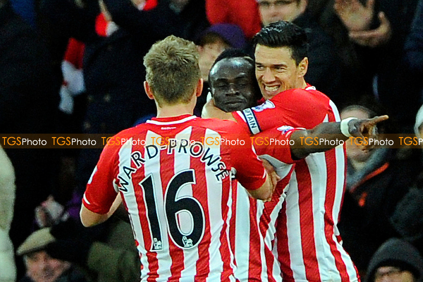 Sadio Mane of Southampton  middle is congratulated by Jose Fonte of Southampton right and James Ward-Prowse of Southampton- Southampton vs Arsenal - Barclays Premier League Football at St Mary's Stadium, Southampton, Hampshire - 01/01/15 - MANDATORY CREDIT: Denis Murphy/TGSPHOTO - Self billing applies where appropriate - contact@tgsphoto.co.uk - NO UNPAID USE