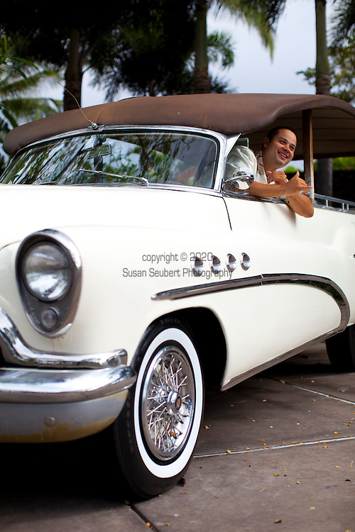 The Four Seasons Resort Hualalai at Historic Kaupulehu on the Big Island of Hawaii. A retro car harkens to days past.