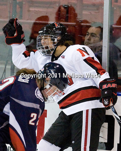 Maggie DiMasi (NU - 4) - The visiting University of Connecticut Huskies defeated the Northeastern University Huskies 4-2 (EN) in NU's senior game on Saturday, February 19, 2011, at Matthews Arena in Boston, Massachusetts.