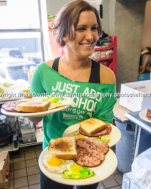 Founder's Irish Pub held its annual St. Patricks Day Kegs and Eggs featuring green eggs and ham and green beer in Bondurant March 17. Breakfast is delivered to the waiting public by server Kourtney Betz of Maxwell.
