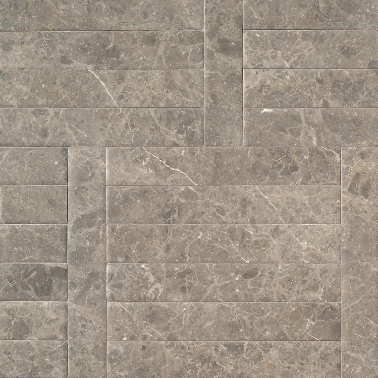 Wicker Grand, a hand-cut stone mosaic, shown in venetian honed Kehena, is part of the Tissé® collection for New Ravenna.