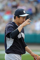 Starting pitcher Masahiro Tanaka (19) of the New York Yankees tips his cap to fans as he is removed from a Spring Training game against the Atlanta Braves on Wednesday, March 18, 2015, at Champion Stadium at the ESPN Wide World of Sports Complex in Lake Buena Vista, Florida. The Yankees won, 12-5. (Tom Priddy/Four Seam Images)