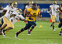 October 6th, 2012: California's Michael Lowe runs down the field after he intercepted UCLA's Brett Hundley during a game at Memorial Stadium, Berkeley, Ca    California defeated UCLA 43 - 17
