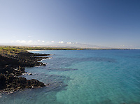 The view of the clear blue water and coastline from Hapuna Beach on the Big Island of Hawaii