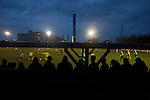 Supporters watching the action during the second-half of the Boxing Day derby match between Runcorn Town and visitors Runcorn Linnets at the Pavilions, Runcorn, in a top-of the table North West Counties League premier division match. Runcorn Linnets won 1-0 and overtook their neighbours at the top of the league in a game watched by 803 spectators. Runcorn Linnets were a successor club to Runcorn FC, one of England foremost non-League clubs of the 1970s and 1980s.