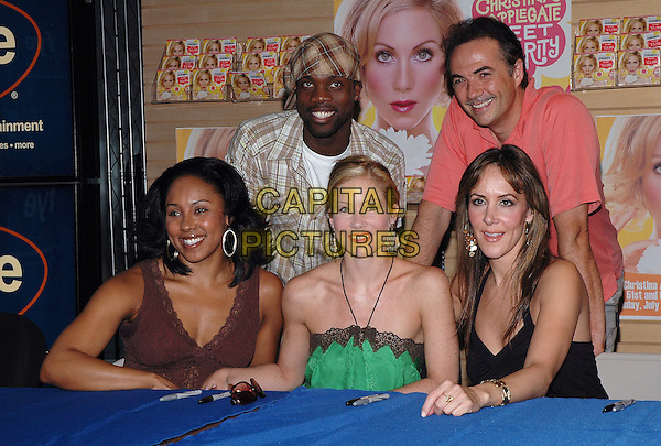 "KYRA DA COSTA, RHETT GEORGE, CHRISTINA APPLEGATE, PAUL SCHOEFFLER & JANINE LAMANNA.Star of the Broadway hit, ""Sweet Charity"" autographs the new cast recording at an FYE store in Manhattan..July 14th, 2005.Photo Credit: Patti Ouderkirk/AdMedia.half length halterneck gold hoop green.www.capitalpictures.com.sales@capitalpictures.com.© Capital Pictures."