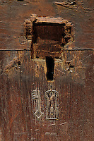 Detail of an oak trunk used to store clothing, late 15th century, with coat of arms of Guigone de Salins (tower and key), originally 1 of 4 identical trunks, in Les Hospices de Beaune, or Hotel-Dieu de Beaune, a charitable almshouse and hospital for the poor, built 1443-57 by Flemish architect Jacques Wiscrer, and founded by Nicolas Rolin, chancellor of Burgundy, and his wife Guigone de Salins, in Beaune, Cote d'Or, Burgundy, France. The hospital was run by the nuns of the order of Les Soeurs Hospitalieres de Beaune, and remained a hospital until the 1970s. The building now houses the Musee de l'Histoire de la Medecine, or Museum of the History of Medicine, and is listed as a historic monument. Picture by Manuel Cohen