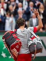 France, Paris, 01.06.2014. Tennis, French Open, Roger Federer (SUI)  goes exit at Roland Garros<br /> Photo:Tennisimages/Henk Koster