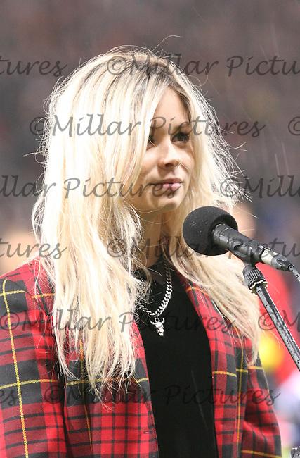 Nina Nesbitt singing Flower of Scotland before the Scotland v Belgium FIFA World Cup Qualifying match at Hampden Park, Glasgow on 6.9.13.