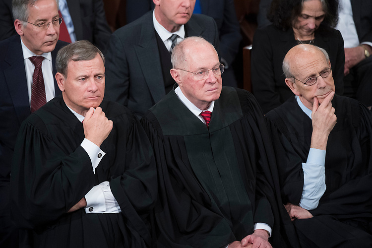 UNITED STATES - FEBRUARY 28: From left, Chief Justice John Roberts Justice Anthony Kennedy, and Justice Stephen Breyer listen to President Donald Trump address a joint session of Congress in the Capitol's House Chamber, February 28, 2017. (Photo By Tom Williams/CQ Roll Call)