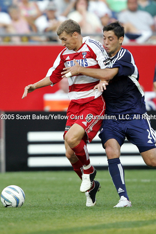 16 July 2005: New England's Clint Dempsey (right) tries to hold back the run of Dallas's Ronnie O'Brien (6). The New England Revolution defeated FC Dallas 3-2 at Gillette Stadium in Foxboro, Massachusetts in a Major League Soccer regular season match..