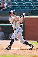 Brett Ryan (1) of the Montgomery Biscuits follows through on his swing against the Chattanooga Lookouts at AT&T Field on July 23, 2014 in Chattanooga, Tennessee.  The Lookouts defeated the Biscuits 6-5. (Brian Westerholt/Four Seam Images)