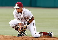 TALLAHASSEE, FL 5/14/10-FSU-NC STATE BASE10 CH-Florida State's Devon Travis bobbles a ball before throwing to first base for the third out of the second inning against N.C. States Friday at Dick Howser Stadium in Tallahassee. The Wolfpack downed the Seminoles 5-2...COLIN HACKLEY PHOTO