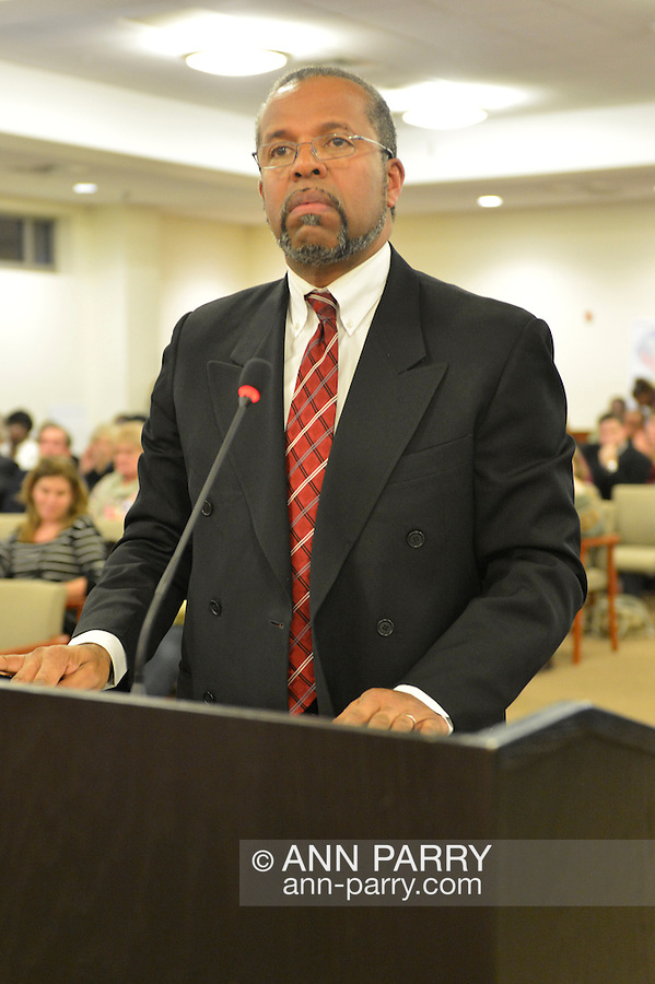 January 3, 2013 - Mineola, New York, U.S. - Attorney FREDERICK BREWINGTON, of Hempstead, speaks against the proposed Republican map at the Nassau County Districting Advisory Commission's night time meeting on two Redistricting maps for the 19 Legislative Districts, one proposed by Republicans, one by Democrats. In the standing room only chambers, dozens shared their views with the commission during the Public Comment segment. After a brief recess, the commission voted at 10:40 PM for each map, neither of which passed. By January 5 it must complete its work for the Nassau Legislature, which must pass a Redistricting map by March 5, 2013.