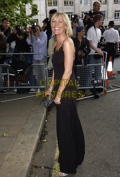 JENNI FALCONER.Attends the Glamour Women of the Year Awards 2005,.Berkeley Square, London, .June 7th 2005..full length black dress funny face laughing jenny.Ref: FIN.www.capitalpictures.com.sales@capitalpictures.com.©Steve Finn/Capital Pictures.