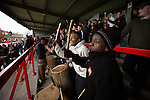 A group of musicians and singers from Uganda playing their drums in the home shed as part of a fundraising initiative at Aggborough, home of Kidderminster Harriers as they played visitors Gainsborough Trinity in a National League North fixture. Harriers were formed in 1886 and have played at their current home since 1890. They won this match  by 3-0 watched by a crowd of 1465.