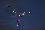 Planes from Team RV fly in formation at dusk during the Rotary festival Saturday at the Lycoming County Fairgrounds.