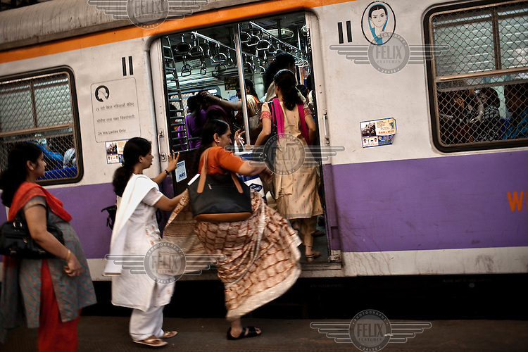 Passengers board a ladies only carriage of a train at Churchgate Station in central Mumbai.