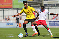 Watford's Joy Mukena and Ivan Nsimbi of Woking challenge for the ball during Woking vs Watford, Friendly Match Football at The Laithwaite Community Stadium on 8th July 2017