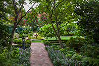 Brick path into the Wisteria Garden room with fountain; Gamble Garden, Palo Alto, California