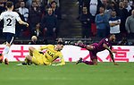 Tottenham Hotspur goalkeeper Hugo Lloris fouls Raheem Sterling of Manchester City during the premier league match at the Wembley Stadium, London. Picture date 14th April 2018. Picture credit should read: Robin Parker/Sportimage