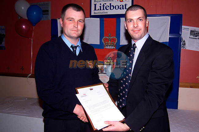 Owen Medland making a presentation, in recognition of the rescue of the fishing vessell the 'March Sod, to Ronan Faulkner at the presentation night in the Big Tree, Clogherhead..Picture: Paul Mohan/Newsfile