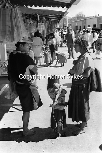 San Cristóbal de las Casas, Mexican state of Chipas Mexico. indigenous Mexican indians with daughter and puppy.