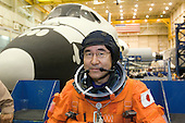 Houston, TX - December 19, 2007 -- Attired in a training version of his shuttle launch and entry suit, astronaut Takao Doi, STS-123 mission specialist representing the Japan Aerospace Exploration Agency (JAXA), takes a moment for a photo during a training session in the Space Vehicle Mockup Facility at the Johnson Space Center in Houston, Texas on December 19, 2007.  STS-123, flying aboard the Space Shuttle Endeavour, is scheduled for launch at 2:28 a.m. EDT Tuesday, March 11, 2008.  Its mission is to deliver the first pressurized component of the Japanese Kibo (Hope) Laboratory and a Canadian robotic device called Dextre utilizing 5 spacewalks.  Its 16-day flight is the longest shuttle mission to date..Credit: NASA via CNP