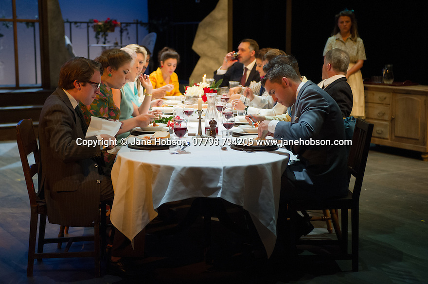 London, UK. 18.07.2014. Mountview Academy of Theatre Arts presents SATURDAY, SUNDAY, MONDAY by Eduardo de Filippo, the English adaptation by Keith Waterhouse & Willis Hall, directed by Michael Howcroft, at the Unicorn Theatre, as part of the Postgraduate Season 2014. Picture shows:  The cast. Photograph © Jane Hobson.