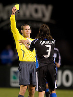 18 April 2009:  Referee Terry Vaughn gives a yellow card to Nick Garcia during the game against the Galaxy at Oakland-Alameda County Coliseum in Oakland, California.   Earthquakes and Galaxy are tied 1-1.