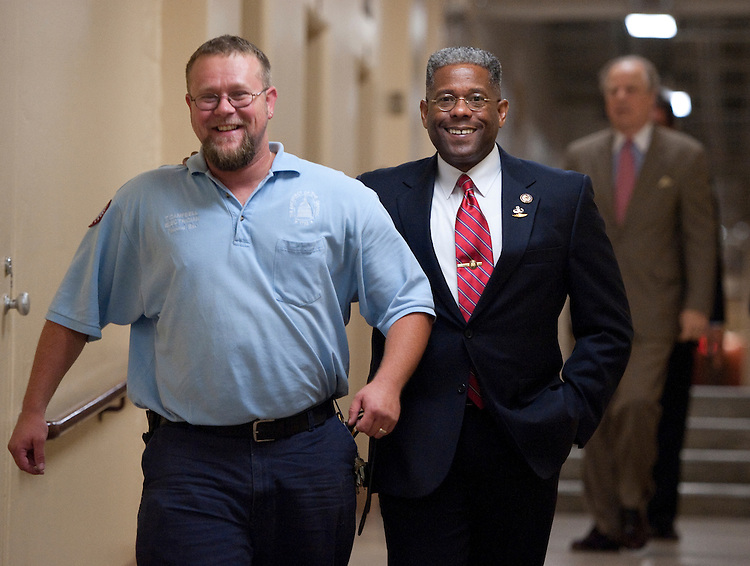 UNITED STATES - JULY 25: Rep. Allen West, R-Fla., puts his arm around an Architect of the Capitol worker as he arrives for a meeting of the House Republican Conference in the basement of the U.S. Capitol on Monday, July 25, 2011. (Photo By Bill Clark/Roll Call)