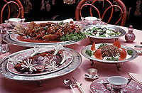 Dishes served at the Mandarin Chinese Restaurant, San Francisco, July 1977, Top Left to Right: Sea Bass, Vegetables. Bottom Left to Right: Peking Duck, Squab. Photo by John G. Zimmerman.
