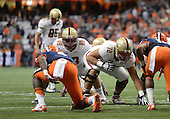 Boston College Eagles lineman Jim Cashman (72) and tight end Michael Giacone (88) prepare to block during a game against the Syracuse Orange at the Carrier Dome on November 30, 2013 in Syracuse, New York.  Syracuse defeated Boston College 34-31.  (Copyright Mike Janes Photography)