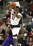Louisville's Chinanu Onuaku (34) comes down with a rebound against Northern Iowa State during the 2015 NCAA Division I Men's Basketball Championship's March 22, 2015 at the Key Arena in Seattle, Washington.  Louisville beat Northern Iowa State 66-53 to advance to the Sweet 16.  ©2015. Jim Bryant Photo. ALL RIGHTS RESERVED.
