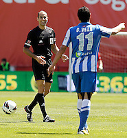 Spanish referee Alfonso Alvarez Izquierdo (l) and Real Sociedad's Carlos Vela during La Liga match.April 14,2013. (ALTERPHOTOS/Acero)