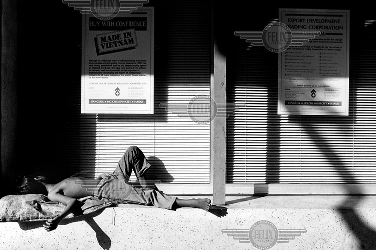 © Jan Banning / Panos Pictures..Saigon, VIETNAM..Young homeless boy sleeping on the street in the centre of the city.