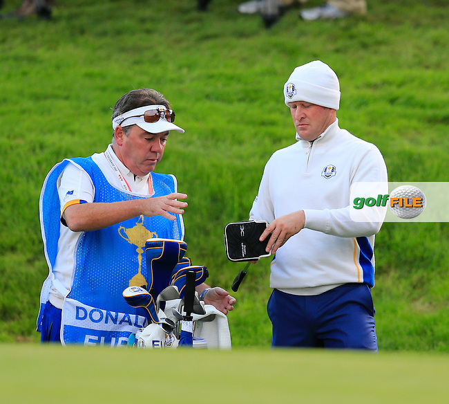 Jamie Donaldson (EUR) and caddy Michael Donaghy at the 1st green during Saturday Mornings Fourball Matches between Europe's Lee Westwood and Jamie Donaldson and USA's Hunter Mahan and Jim Furyk of the Ryder Cup 2014 played on the PGA Centenary Course at the Gleneagles Hotel, Auchterarder, Scotland.: Picture Eoin Clarke, www.golffile.ie : 27th September 2014