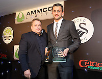 Pictured: Lukasz Fabianski receiving the away player of the season award Wednesday 20 May 2015<br /> Re: Swansea City FC Awards Dinner at the Liberty Stadium, south Wales, UK